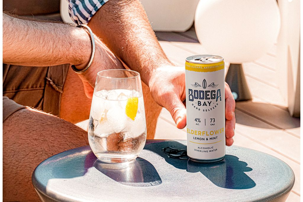Can of Bodega Bay hard seltzer with a glass